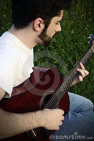 Man playing acoustic guitar