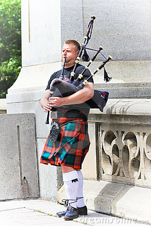 A man is playing bagpipe. Editorial Stock Photo