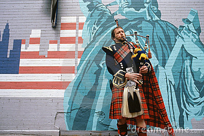 Man playing bagpipes Editorial Stock Photo