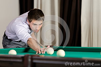 Man playing billiard at gambling house