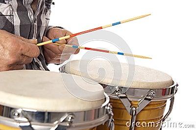 Man playing bongo with sticks