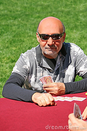 Man playing cards at picnic