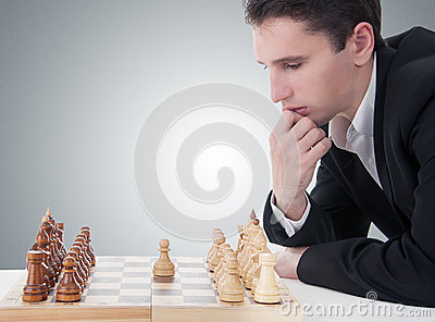 Man playing chess, making the move