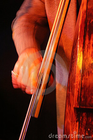 A man playing contrabass with one hand