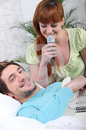 Man playing guitar for girlfriend
