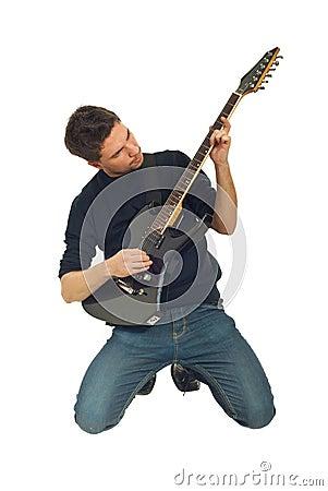Man playing guitar in knees
