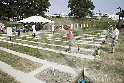 Man playing horse shoes Editorial Stock Photo