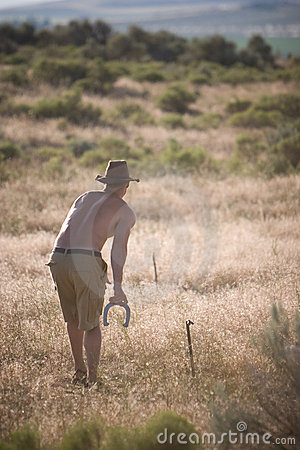 Man Playing Horseshoes