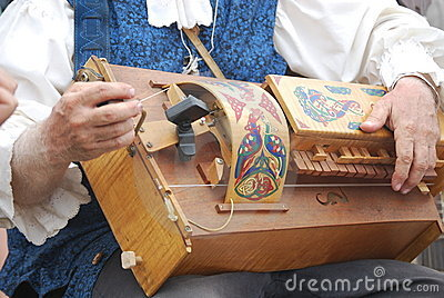Man playing hurdy gurdy