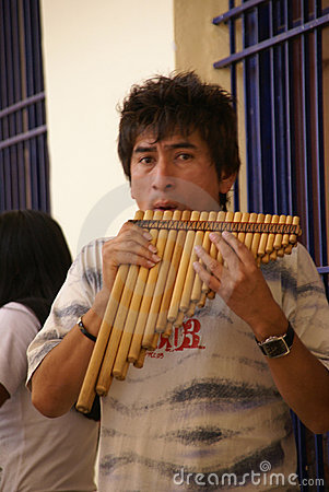 Man playing pan pipes Editorial Image