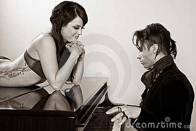 Man Playing the Piano for a Woman