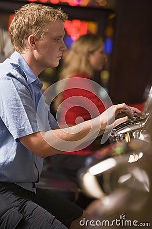 Man Playing Slot Machines