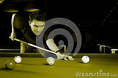 Man playing snooker.