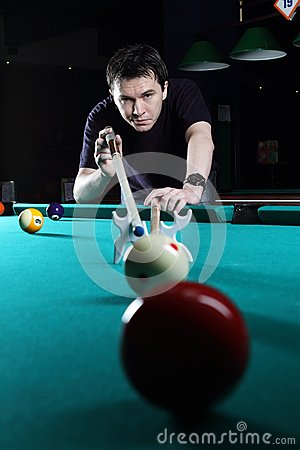 Man playing snooker.