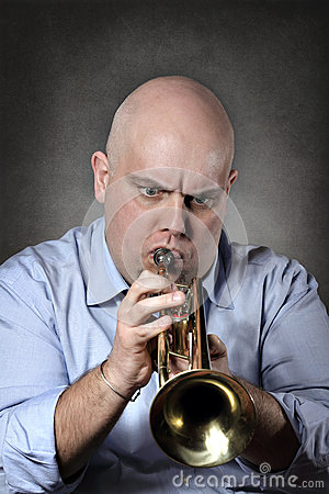 Man playing trumpet with focused expression