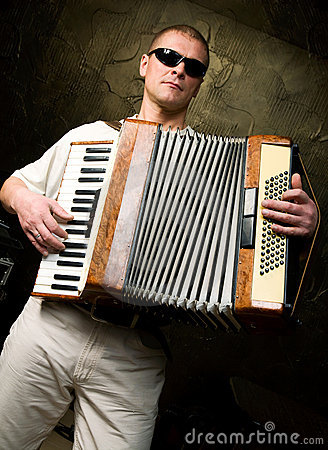 A man plays the accordion