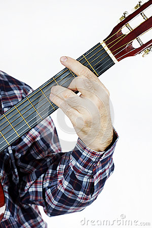 Man plays a chord on the guitar