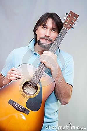 Free Man Plays The Guitar Royalty Free Stock Photos - 27904618