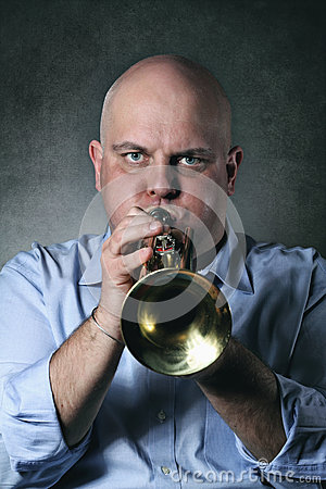 Man plays a trumpet