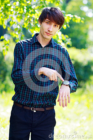 Free Man Pointing At His Watch Royalty Free Stock Image - 30837726