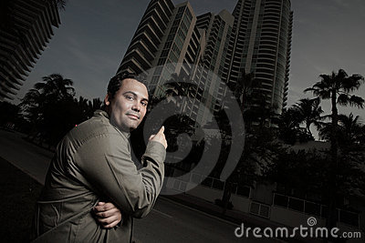 Man pointing at a building