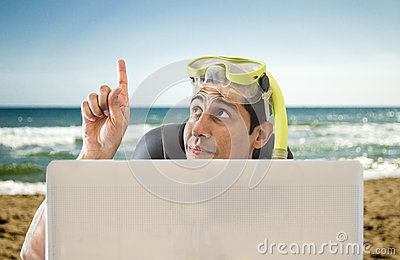 Man pointing his finger to beach