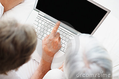 Man pointing out your product on the laptop screen