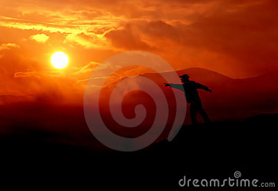 Man pointing at the sun
