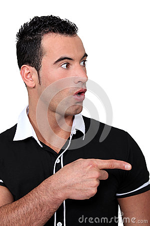 Man pointing in surprise