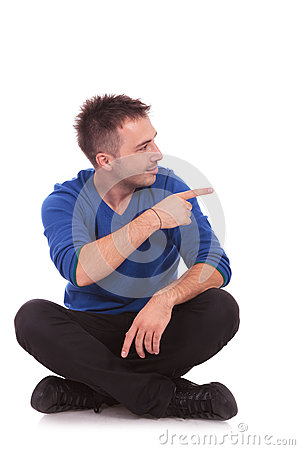 Man pointing to his left side