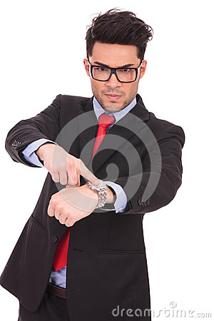 Free Man Pointing To His Watch Stock Photography - 29374432