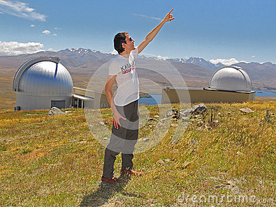 Man pointing to sky Editorial Stock Image
