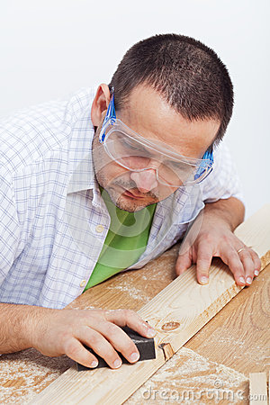 Man polishing wooden planck