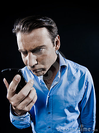 Man Portrait Angry looking at telephone smartphone