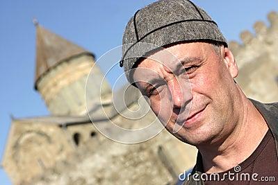 Man poses in national georgian hat