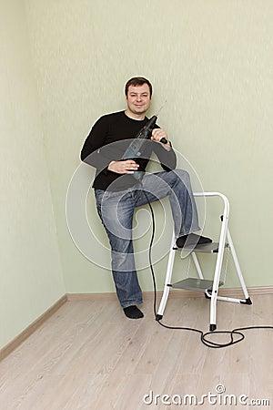 Free Man Poses With Perforator Stock Photo - 12789120