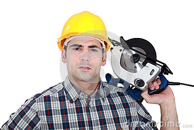 Man posing with electrical saw