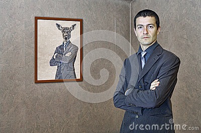 Man posing by a funny painting