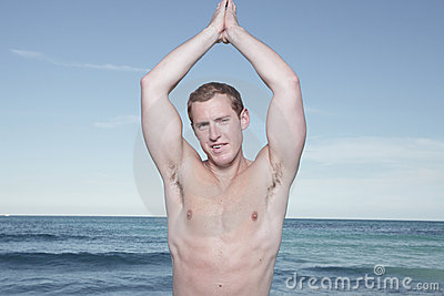 Man posing with hands above head