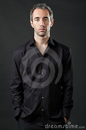 Free Man Posing In Black Shirt On Dark Background. Stock Image - 21824941