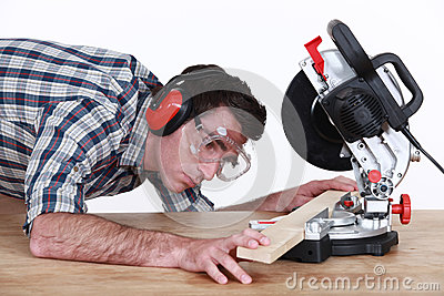 Man positioning plank of wood