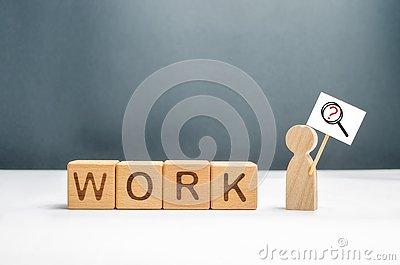 Man with a poster and a magnifying glass near the cubes with the word work. Man in search of work or part-time job. Headhunters Stock Photo