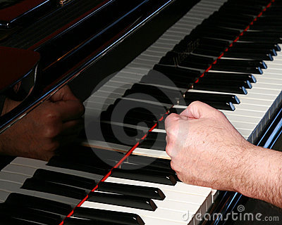 Man pounding fist on piano