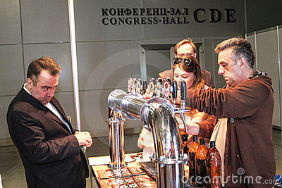 Man pouring beer to glass from beer tap Editorial Stock Photo