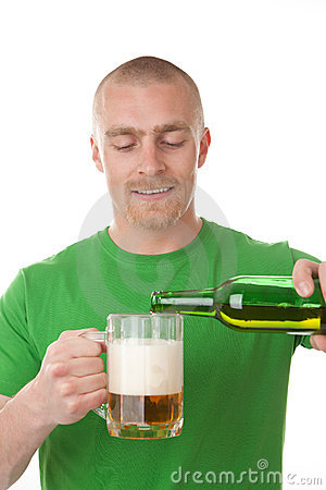 Man pouring glass of beer