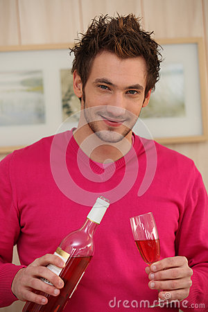 Man pouring wine in a glass