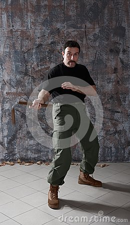 Man practice martial arts with nunchaku