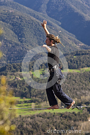 Man practicing Highline Editorial Stock Image