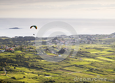 Man practicing paragliding at dusk