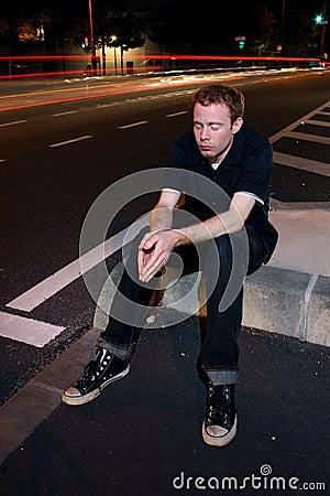 Man Praying in City